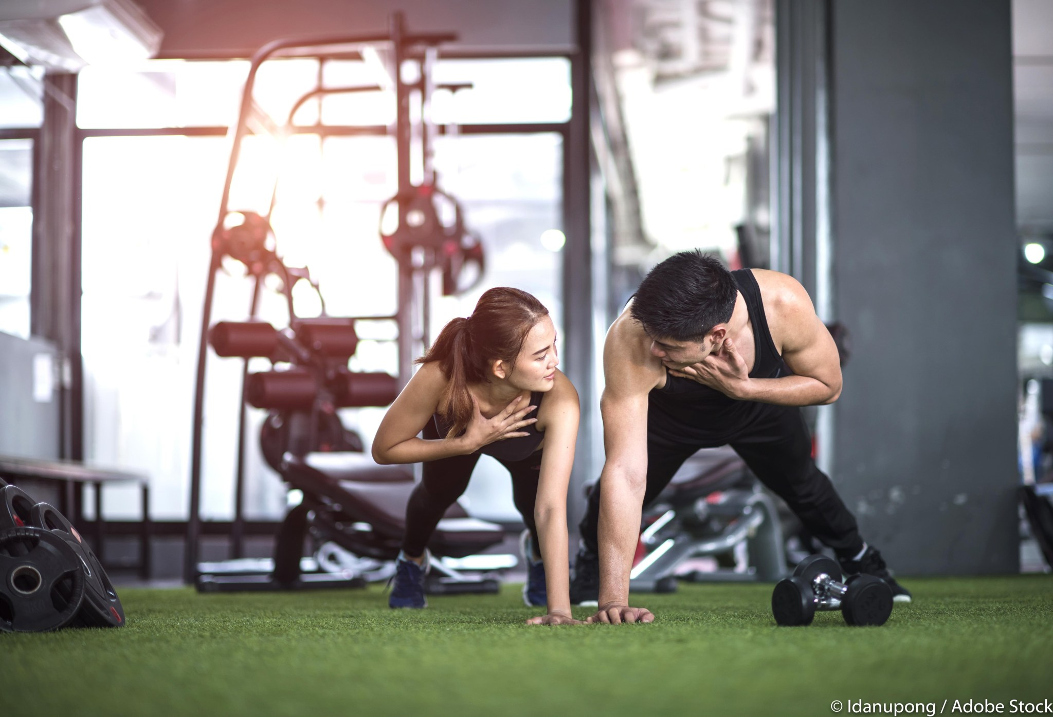 couple lover training exercise together in gymnasium