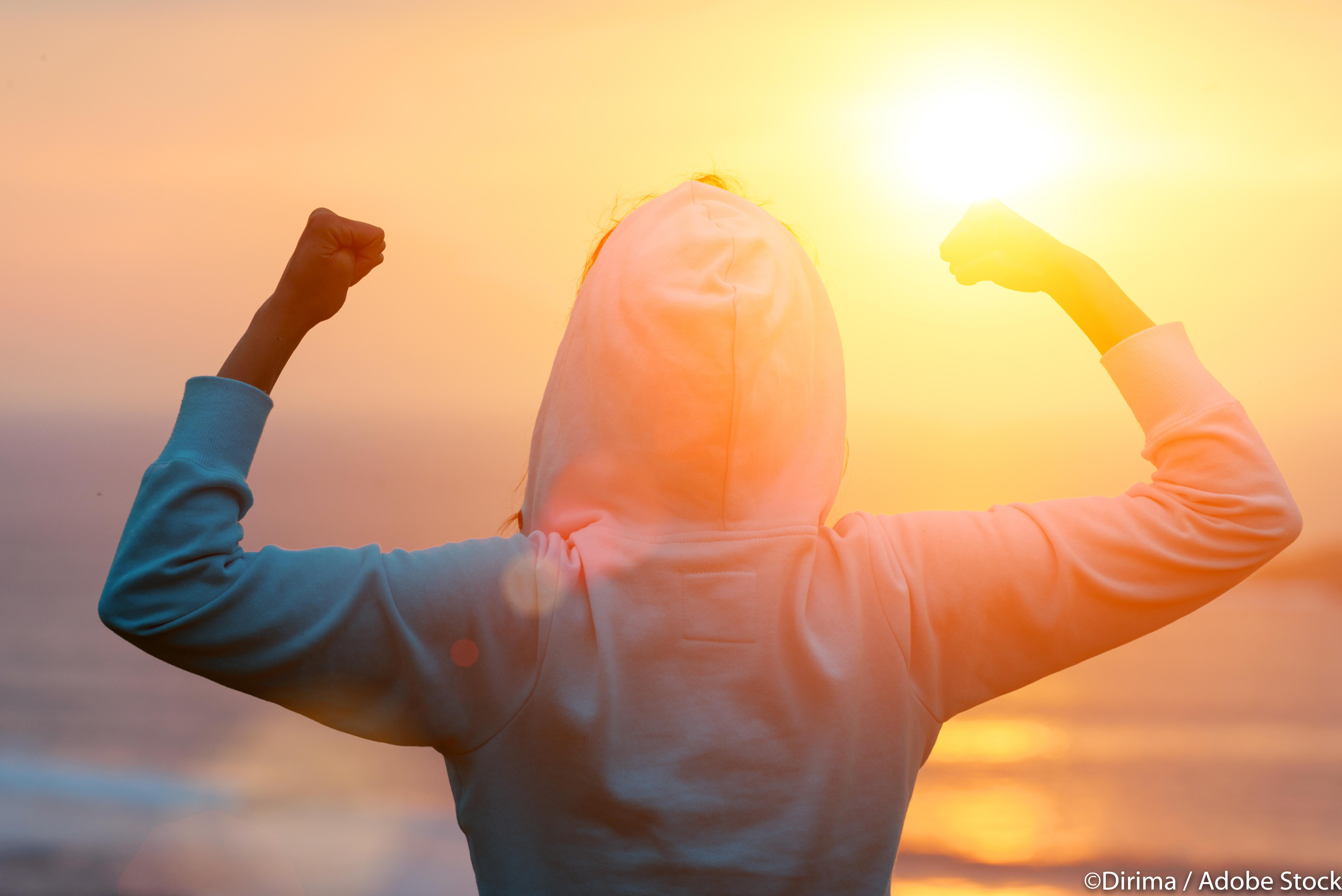 Celebrating fitness workout success towards the sun